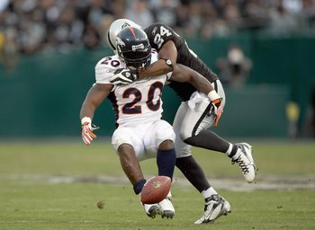 OAKLAND, CA - DECEMBER 2: Travis Henry #20 of the Denver Broncos is tackled by Michael Huff #24 of the Oakland Raiders during an NFL game December 2, 2007 at McAfee Coliseum in Oakland, California. (Photo by Jed Jacobsohn/Getty Images)