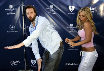 LOS ANGELES - JULY 12:  Comedian Tom Green (L) and TV host Jillian Barberie arrive for a celebrity tennis tournament before the start the 78th Annual Mercedes-Benz Cup Tennis Tournament at UCLA July 12, 2004 in Los Angeles, California.   (Photo by Carlo A