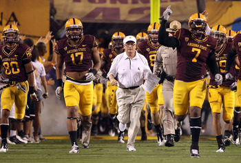 TEMPE, AZ - SEPTEMBER 04:  Head coach Dennis Erickson of the Arizona State Sun Devils runs onto the field before the college football game against the Portland State Vikings at Sun Devil Stadium on September 4, 2010 in Tempe, Arizona.  The Sun Devils defe