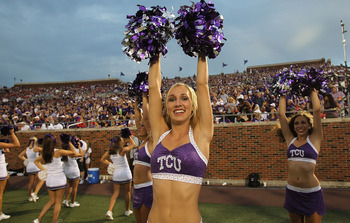 DALLAS - SEPTEMBER 24: A TCU Horned Frogs cheerleader performs at Gerald J. Ford Stadium on September 24, 2010 in Dallas, Texas.  (Photo by Ronald Martinez/Getty Images)