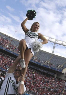 ORLANDO, FL - JANUARY 1: A cheerleader of the Michigan State Spartans entertains during play against the Georgia Bulldogs at the 2009 Capital One Bowl at the Citrus Bowl on January 1, 2009 in Orlando, Florida.  (Photo by Al Messerschmidt/Getty Images)