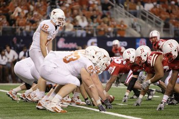 ARLINGTON, TX - DECEMBER 5: Colt McCoy #12 of the Texas Longhorns calls the play at the line of scrimmage during the Big 12 Football Championship game against the Nebraska Cornhuskers at Cowboys Stadium on December 5, 2009 in Arlington, Texas. (Photo by J