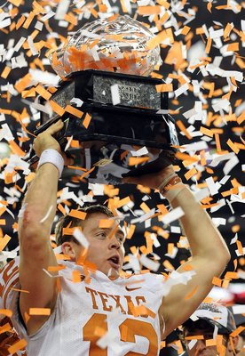 ARLINGTON, TX - DECEMBER 05:  Quarterback Colt McCoy #12 of the Texas Longhorns lifts the Big 12 Championship trophy at Cowboys Stadium on December 5, 2009 in Arlington, Texas.  (Photo by Ronald Martinez/Getty Images)