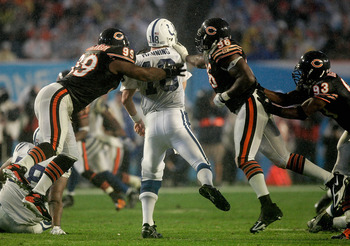 MIAMI GARDENS, FL - FEBRUARY 04:  Tank Johnson #99 and Alex Brown #96 of the Chicago Bears try to sack quarterback Peyton Manning #18 of the Indianapolis Colts during the fourth quarter of Super Bowl XLI on February 4, 2007 at Dolphin Stadium in Miami Gar