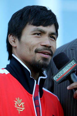 ARLINGTON, TX - MARCH 12:  Manny Pacquiao of the Philippines smiles after he steps on the scale during the weigh-in for his WBO welterweight title fight against Joshua Clottey of Ghana outside Cowboys Stadium on March 12, 2010 in Arlington, Texas. Pacquia