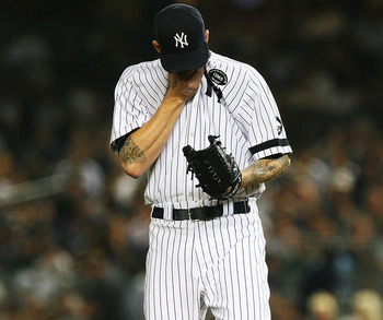 NEW YORK - SEPTEMBER 22:  A.J. Burnett #34 of the New York Yankees wipes his brow during a game against the Tampa Bay Rays on September 22, 2010 at Yankee Stadium in the Bronx borough of New York City.  (Photo by Andrew Burton/Getty Images)