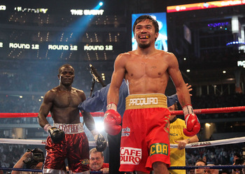 ARLINGTON, TX - MARCH 13:  (R-L) Manny Pacquiao of the Philippines smiles in the ring after the final bell against Joshua Clottey of Ghana during the WBO welterweight title fight at Cowboys Stadium on March 13, 2010 in Arlington, Texas. Pacquiao defeated