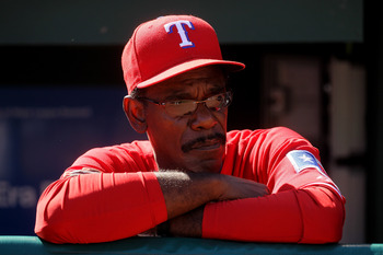ARLINGTON, TX - OCTOBER 09:  Manager Ron Washington of the Texas Rangers looks on from the dugout before the game with the Tampa Bay Rays during game three of the ALDS at Rangers Ballpark in Arlington on October 9, 2010 in Arlington, Texas.  (Photo by Ste