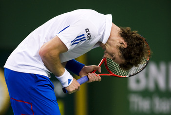 SHANGHAI, CHINA - OCTOBER 14:  Andy Murray of Great Britain reacts during his match against Jeremy Chardy of France during day four of the 2010 Shanghai Rolex Masters at the Shanghai Qi Zhong Tennis Center on October 14, 2010 in Shanghai, China.  (Photo b