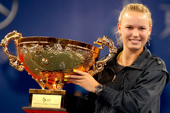BEIJING - OCTOBER 11:  Caroline Wozniacki of Denmark poses with the trophy after defeating Vera Zvonareva of Russia in the Women's Singles final on day eleven of the 2010 China Open at the National Tennis Center on October 11, 2010 in Beijing, China.  (Ph