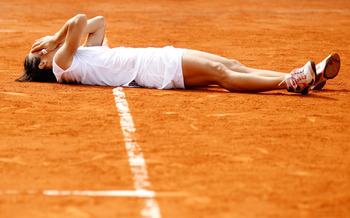 PARIS - JUNE 05:  Francesca Schiavone of Italy celebrates wnining championship point during women's singles final match between Francesca Schiavone of Italy and Samantha Stosur of Australia on day fourteen of the French Open at Roland Garros on June 5, 20