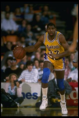 1989-1990:  Guard Earvin (Magic) Johnson of the Los Angeles Lakers moves the ball during a game. Mandatory Credit: Stephen Dunn  /Allsport Mandatory Credit: Stephen Dunn  /Allsport