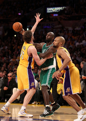 LOS ANGELES, CA - JUNE 15:  Kevin Garnett #5 of the Boston Celtics passes the ball over Pau Gasol #16 and Derek Fisher #2 of the Los Angeles Lakers in Game Six of the 2010 NBA Finals at Staples Center on June 15, 2010 in Los Angeles, California.  NOTE TO