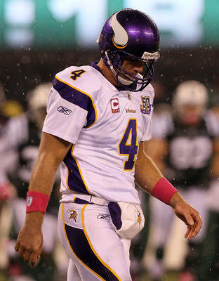 EAST RUTHERFORD, NJ - OCTOBER 11:  Quarterback Brett Favre #4 of the Minnesota Vikings walks back to the sideline against the New York Jets at New Meadowlands Stadium on October 11, 2010 in East Rutherford, New Jersey.  (Photo by Jim McIsaac/Getty Images)