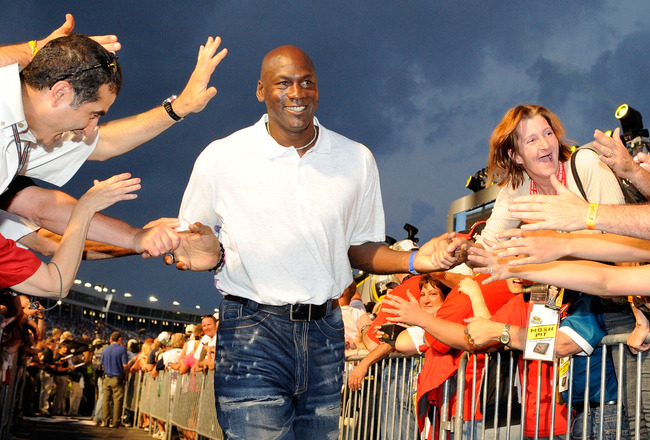 CONCORD, NC - MAY 22:  Former NBA Chicago Bulls gaurd Michael Jordon high-fives the crowd during pre-race ceremonies prior to the start of the NASCAR Sprint All-Star Race at Charlotte Motor Speedway on May 22, 2010 in Concord, North Carolina.  (Photo by J