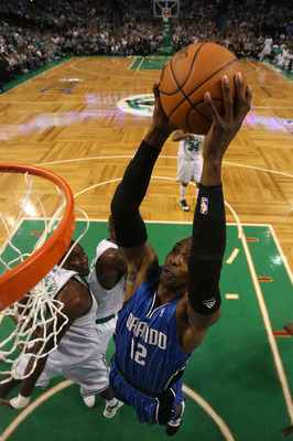 BOSTON - MAY 28:  Dwight Howard #12 of the Orlando Magic dunks against the Boston Celtics in Game Six of the Eastern Conference Finals during the 2010 NBA Playoffs at TD Garden on May 28, 2010 in Boston, Massachusetts.  NOTE TO USER: User expressly acknow