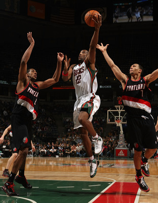 MILWAUKEE - MARCH 07:  Michael Redd #22 of the Milwaukee Bucks goes up for a shot between LaMarcus Aldridge #12 and Brandon Roy #7 of the Portland Trail Blazers at the Bradley Center March 7, 2008 in Milwaukee, Wisconsin. NOTE TO USER: User expressly ackn