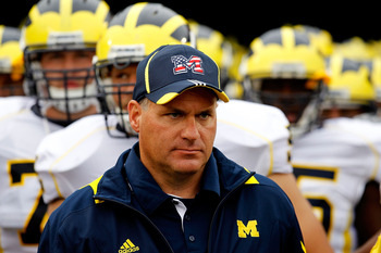 SOUTH BEND, IN - SEPTEMBER 11: Head coach Rich Rodriguez of the Michigan Wolverines waits with his team before entering the field for a game against the Notre Dame Fighting Irish at Notre Dame Stadium on September 11, 2010 in South Bend, Indiana. Michigan