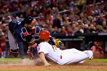 ST. LOUIS - APRIL 26: Colby Rasmus #28 of the St. Louis Cardinals is tagged out by Brian McCann #16 of  the Atlanta Braves at Busch Stadium on April 26, 2010 in St. Louis, Missouri.  The Cardinals beat the Braves 4-3.  (Photo by Dilip Vishwanat/Getty Imag