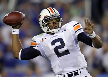 LEXINGTON, KY - OCTOBER 09:  Cam Newton #2 of the Auburn Tigers throws a pass during the SEC game against the Kentucky Wildcats at Commonwealth Stadium on October 9, 2010 in Lexington, Kentucky.  (Photo by Andy Lyons/Getty Images)