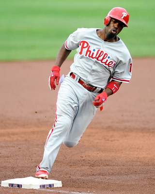 WASHINGTON - AUGUST 01:  Jimmy Rollins #11 of the Philadelphia Phillies rounds third base and scores in the seventh inning against the Washington Nationals at Nationals Park on August 1, 2010 in Washington, DC.  (Photo by Greg Fiume/Getty Images)