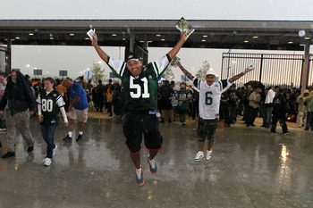 EAST RUTHERFORD, NJ - SEPTEMBER 13: Rain falls on Jets fans as they enter the west gate to watch the New York Jets play against the Baltimore Ravens prior to the home opener at the New Meadowlands Stadium on September 13, 2010 in East Rutherford, New Jers