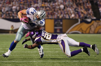 MINNEAPOLIS - OCTOBER 17:  Fullback Chris Gronkowski #44 of the Dallas Cowboys is hit by Antoine Winfield #26 of the Minnesota Vikings during the second quarter at Mall of America Field on October 17, 2010 in Minneapolis, Minnesota. The Vikings defeated t