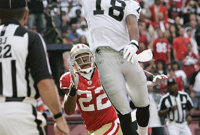 SAN FRANCISCO - AUGUST 22:   Oakland Raiders wide receiver Louis Murphy #18 tries to make a catch as San Francisco 49ers cornerback Nate Clements #22 defends in the 1st quarters as the San Francisco 49ers host the Oakland Raiders at Candlestick Park Augus