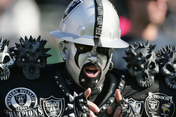 OAKLAND, CA - DECEMBER 19:  A fan of the Oakland Raiders cheers during the game against the Tennessee Titans at Network Associates Coliseum on December 19, 2004 in Oakland, California. (Photo by Jed Jacobsohn/Getty Images)