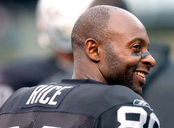 OAKLAND, CA - OCTOBER 17:  Jerry Rice #80 of the Oakland Raiders smiles on the bench during a game against the Denver Broncos at the Network Associates Coliseum on October 17, 2004 in Oakland, California.  It turned out to be his last game in a Raider uni