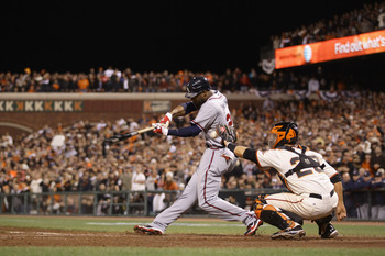 SAN FRANCISCO - OCTOBER 07:  Jason Heyward #22 of the Atlanta Braves bats against catcher Buster Posey #28 and the San Francisco Giants during game 1 of the NLDS at AT&T Park on October 7, 2010 in San Francisco, California.  (Photo by Ezra Shaw/Getty Imag