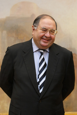 LONDON - NOVEMBER 07:  Russian oligarch Alisher Usmanov stands in front of JMW Turner's painting ' The Harbour of Brest ' in the Tate Britain art gallery  on November 7, 2008 in London, England. The Pushkin Museum in Moscow is hosting a major exhibition o