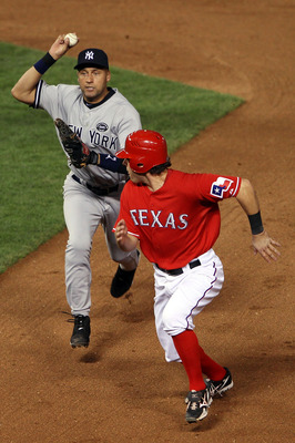 ARLINGTON, TX - OCTOBER 15:  Ian Kinsler #5 of the Texas Rangers is caught in a run down attempting to steal second base against Derek Jeter #2 of the New York Yankees in Game One of the ALCS during the 2010 MLB Playoffs at Rangers Ballpark in Arlington o