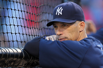 ARLINGTON, TX - OCTOBER 15:  Manager Joe Girardi of the New York Yankees looks on during batting practice before Game One of the ALCS during the 2010 MLB Playoffs against the Texas Rangers at Rangers Ballpark in Arlington on October 15, 2010 in Arlington,