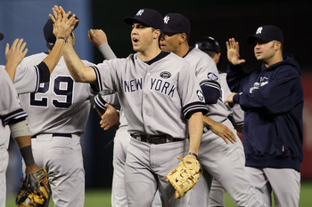 ARLINGTON, TX - OCTOBER 15:  Mark Teixeira #25 and the New York Yankees celebrate after defeating the Texas Rangers by a score of 6-5 to win Game One of the ALCS during the 2010 MLB Playoffs at Rangers Ballpark in Arlington on October 15, 2010 in Arlingto