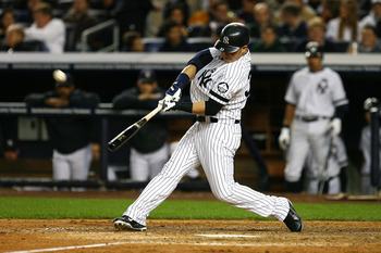 NEW YORK - OCTOBER 09:  Nick Swisher of the New York Yankees hits a solo home run in the bottom of the seventh inning against the Minnesota Twins during Game Three of the ALDS part of the 2010 MLB Playoffs at Yankee Stadium on October 9, 2010 in the Bronx