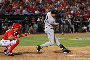 ARLINGTON, TX - OCTOBER 15:  Derek Jeter #2 of the New York Yankees hits a RBI double in the top of the eighth inning against the Texas Rangers in Game One of the ALCS during the 2010 MLB Playoffs at Rangers Ballpark in Arlington on October 15, 2010 in Ar
