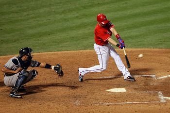 ARLINGTON, TX - OCTOBER 15:   Michael Young #10 of the Texas Rangers hits a two run RBI in the fourth inning against the New York Yankees in Game One of the ALCS during the 2010 MLB Playoffs at Rangers Ballpark in Arlington on October 15, 2010 in Arlingto