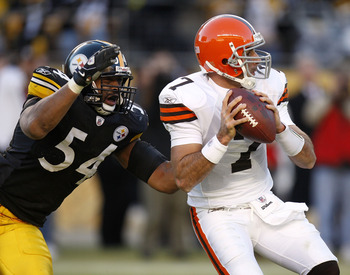 PITTSBURGH - DECEMBER 28:  Bruce Gradkowski #7 of the Cleveland Browns gets sacked by Andre Frazier #54 of the Pittsburgh Steelers during the fourth quarter at Heinz Field December 28, 2008 in Pittsburgh, Pennsylvania. Pittsburgh won the game 31-0.  (Phot