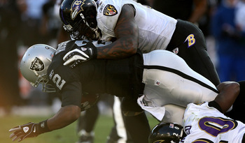 OAKLAND, CA - JANUARY 3: Terrell Suggs #55 of the Baltimore Ravens tackles JaMarcus Russell #2 of the Oakland Raiders during an NFL game at Oakland-Alameda County Coliseum on January 3, 2010 in Oakland, California. (Photo by Jed Jacobsohn/Getty Images)