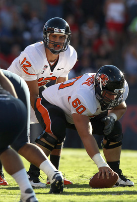 TUCSON, AZ - OCTOBER 09:  Quarterback Ryan Katz #12 of the Oregon State Beavers prepares to snap the ball during the college football game against the Arizona Wildcats at Arizona Stadium on October 9, 2010 in Tucson, Arizona.  The Beavers defeated the Wil