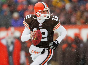 CLEVELAND - DECEMBER 19:  Luke McCown #12 of the Cleveland Browns rolls out of the pocket against the San Diego Chargers December 19, 2004 at Cleveland Browns Stadium in Cleveland, Ohio.  (Photo by Matthew Stockman/Getty Images)