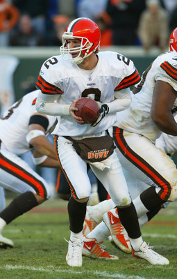 CINCINNATI - DECEMBER 28:  Quarterback Tim Couch #2 of the Cleveland Browns prepares to hand the ball off during the game against the Cincinnati Bengals on December 28, 2003 at Paul Brown Stadium in Cincinnati, Ohio. The Browns won 22-14.(Photo by Andy Ly