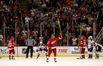 DETROIT - JANUARY 08:  Chris Chelios #24 of the Detroit Red Wings waves to fans after being announced as the second oldest player to play in a NHL game while playing the Colorado Avalanche on January 8, 2008 at Joe Louis Arena in Detroit, Michigan.  (Phot