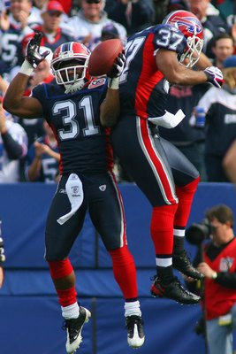 ORCHARD PARK, NY - NOVEMBER 01:  Jairus Byrd #31 and George Wilson #37 of the Buffalo Bills celebrate during the game against the Houston Texans at Ralph Wilson Stadium on November 1, 2009 in Orchard Park, New York. Houston won 31-10. (Photo by Rick Stewa
