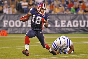 TORONTO, CANADA - AUGUST 19: Naaman Roosevelt #18 of the Buffalo Bills avoids the the tackle of Gijon Robinson #47 of the Indianapolis Colts during game action August 19, 2010 at the Rogers Centre in Toronto, Ontario, Canada. (Photo by Brad White/Getty Im