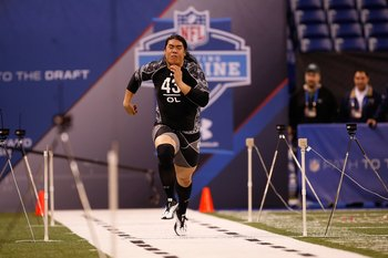 INDIANAPOLIS, IN - FEBRUARY 27: Offensive lineman Ed Wang of Virginia Tech runs the 40 yard dash during the NFL Scouting Combine presented by Under Armour at Lucas Oil Stadium on February 27, 2010 in Indianapolis, Indiana. (Photo by Scott Boehm/Getty Imag
