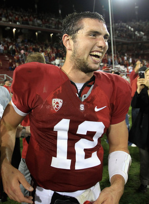 PALO ALTO, CA - OCTOBER 09:  Andrew Luck #12 of the Stanford Cardinal is surrounded by teammates and fans after they beat the USC Trojans 37-35 at Stanford Stadium on October 9, 2010 in Palo Alto, California.  (Photo by Ezra Shaw/Getty Images)