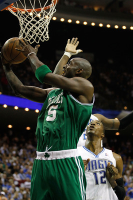 Garnett tries to lay the ball in against Dwight Howard and the Magic.