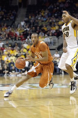 Avery Bradley dribbles past Iowa's defense.